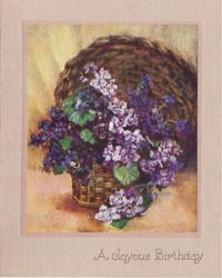 A JOYOUS BIRTHDAY purple & mauve violets in woven basket