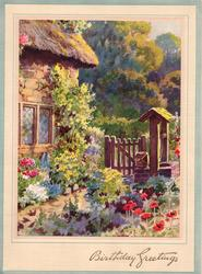 BIRTHDAY GREETINGS in gilt, corner of cottage with flower garden, wooden gate & well, poppies front, trees behind