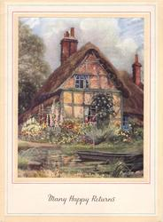 MANY HAPPY RETURNS in gilt, row boat on water front-right, cottage with thatched roof & flower garden behind