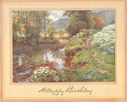 A HAPPY BIRTHDAY in gilt, water's edge with grass & shrubbery, 4 cows graze beyond trees in distance
