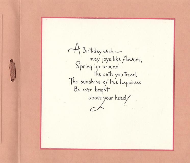 MANY HAPPY RETURNS in gilt, burgundy & pink chrysanthemums in purple pot, two books front, brown ribbon