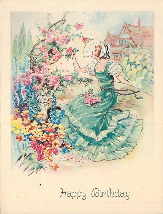 HAPPY BIRTHDAY lady in green ruffled dress faces left picking roses off bush, house in background