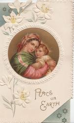 PEACE ON EARTH in gilt, Mary cuddles young Jesus in circular inset, embossed white & blue  design  with stylised lilies