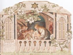 A BLESSED CHRISTMAS TO YOU in gilt, pink & white embossed wild roses above perforation showing Mary, Jesus & many adoring angels