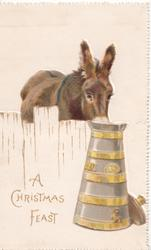 A CHRISTMAS FEAST in gilt below left, donkey leans over fence to drink milk from churn, embossed