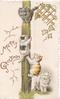 MERRY GREETINGS in gilt, inset of two kittens climbing a pole brown & grey kitten looks down fron top of pole lattice design, stylised ivy leaves, white kitten below