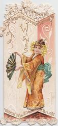 WISHES in gilt above Japanese girl holding fan, facing left looking front in front of complex perforated design