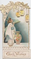 GOOD WISHES in gilt below girl in kimono holding fan looking up at Japanese lanterns