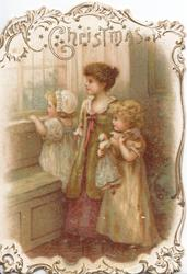 CHRISTMAS above mother with two girls looking out of window, old style dress, white & gilt perforated marginal design