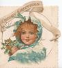 CHEERY GREETINGS in gilt above perforations round girls head, in blue, with holly
