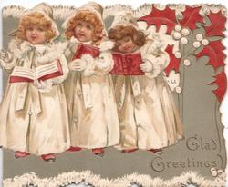 GLAD GREETINGS in gilt, 3 girls in white stand in line holding books, perforated stylised holly right