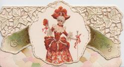 GOOD WISHES in gilt divided by inset of woman dressed in red standing with cane & fan, elaborate perforated design