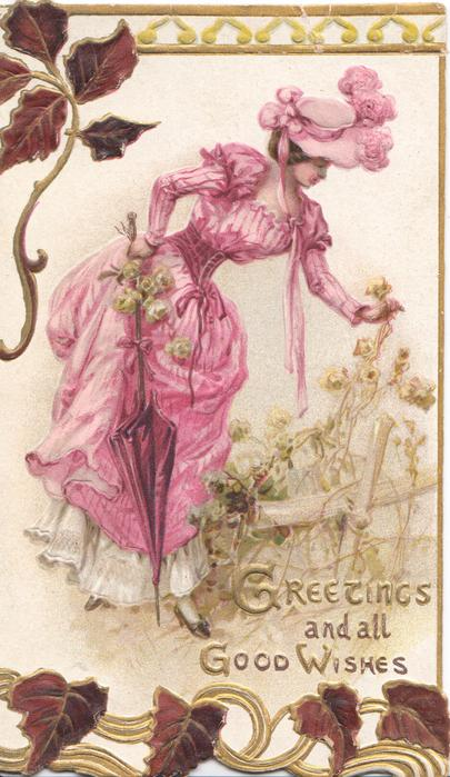 GREETINGS AND ALL GOOD WISHES in gilt below woman in pink holding parasol bending to hold flower, stylised ivy