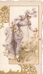 GREETINGS in gilt below woman in white holding parasol bending to hold flower, gilt designs in margins