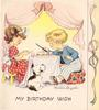 MY BIRTHDAY WISH girl & boy sit at tiny table to eat cake, dog looks on, panel with bow right