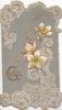 GREETINGS(G illuminated) in gilt,  white anemones, embossed, elaborate white designs above & below, grey background