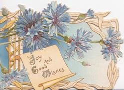 JOY AND GOOD WISHES(J, G, & W illuminated) in gilt below blue cornflowers, embossed, perforated design