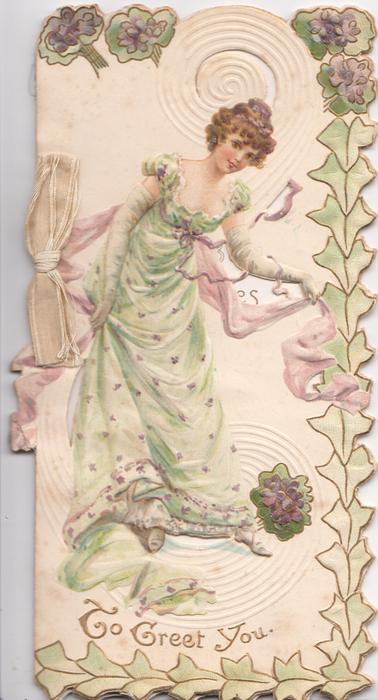 TO GREET YOU in gilt below woman in green holding pink throw behind her back, stylised ivy & violets at margins