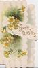 GOOD WISHES in gilt on white design, yellow primroses around