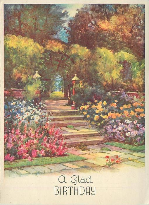 A GLAD BIRTHDAY stone steps divide flower garden, many trees in distance, red flower grows in crack, front