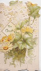 TO GREET YOU in gilt on white placard above yellow daisies, ivy right, white perforated design above