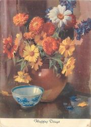 HAPPY DAYS white & blue china bowl left of brown vase with yellow & white asters, orange chrysanthemums & blue flowers