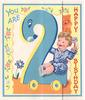YOU ARE 2, child rides large number 2 with wheels, stylised flowers on yellow scalloped border with blue trim, HAPPY BIRTHDAY right