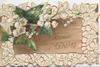 GOOD WISHES  in gilt on brown board, ivy flowers & leaves upper left & complex marginal perforated leaf design