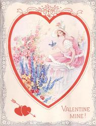 VALENTINE MINE! girl in pink dress sits on railing, bluebird on her hand, flower garden left, framed by large red heart & silvered floral border