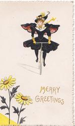 MERRY GREETINGS in gilt, girl cycles front, 2 yellow daisies lower left
