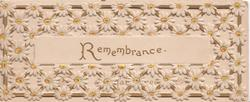REMEMBRANCE in gilt on central inset surronded by perforated design of white daises with yellow centres
