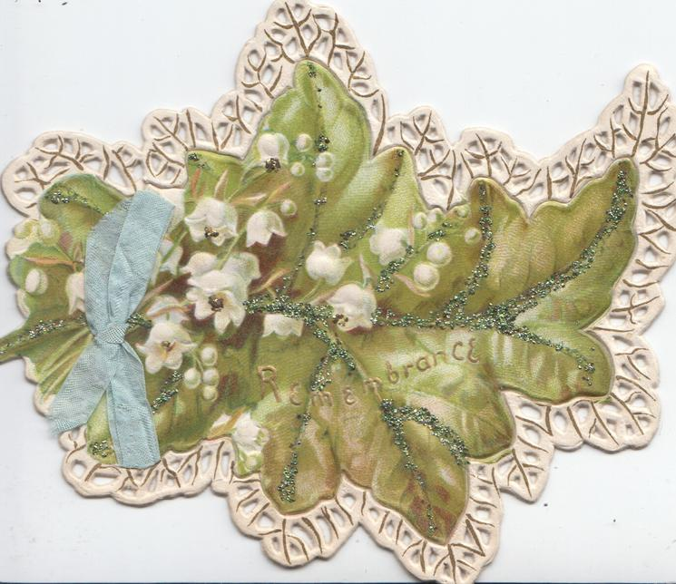 REMEMBRANCE in gilt, below lilies-of-the valley in front of ivy leaves ,perforated white & marginal design, blue bow left