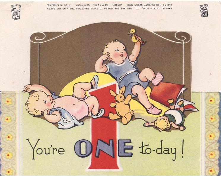 YOU'RE ONE TO-DAY! large red 1,  two babies lie on their backs, die-cut gilt background, stylised floral side panels