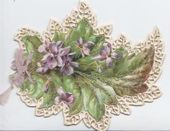 GREETINGS in gilt, violets & leaves surrounded by perforated white marginal design, ribbon bow left