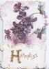 HAPPINESS(H illuminated & glittered ) on white plaque below violets on pale pnk backgound