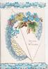GOOD WISHES on white plaque surrounded by heart shaped design of  forget-me-nots & ivy, top & bottom marginal design of forget-me-nots