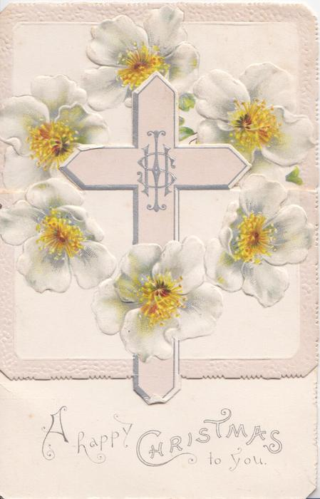 A HAPPY CHRISTMAS at base of card central pale pink cross on folded front flap, circlet of white anemones