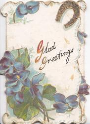 GLAD GREETINGS, blue violets below left, glittered gilt horseshoe top right