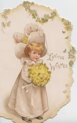 LOVING WISHES right, girl in long dress & ostrich feather hat stands holding bouquet of yellow primroses