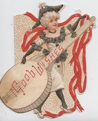 GOOD WISHES in red across enormous banjo, blonde girl in black & white dances