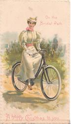 ON THE BRIDAL PATH above , A HAPPY CHRISTMAS TO YOU below in pink, girl rides bicycle front /right