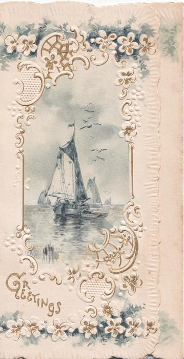 GREETINGS in gilt, inset of sailing boats on ocean, surrouded by ornate floral & white embossed design