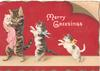 MERRY GREETINGS in white on purple background, cat carrying kitten followed by 2 kittens all walk left on hind legs