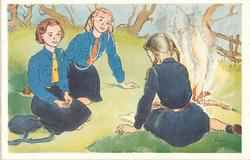 no front title, three girl guides sit near small campfire in grassy meadow