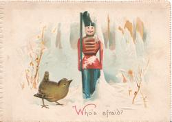 WHO'S AFRAID? winter scene, wren looks up at humanized stick soldier