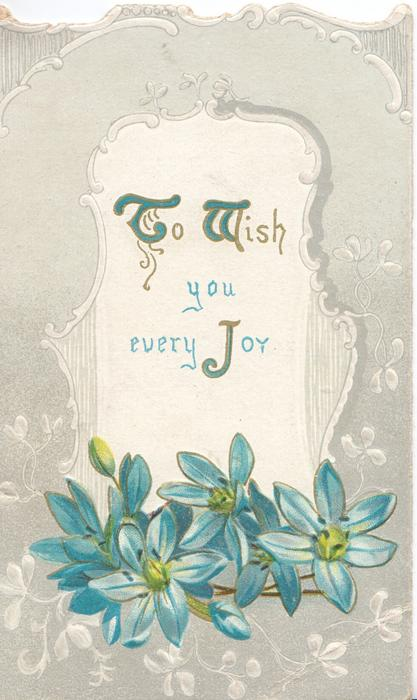 TO WISH YOU JOY(T.W & J illuminated) in gilt on white plaque above blue anemones, whire design on grey background