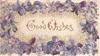 GOOD WISHES in gilt at centre framed by violets
