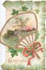 GREETINGS in gilt, rural inset in gilt bordered red handled fan-shaped perforated design,  ivy leaves above & below, gilt & green marginal design