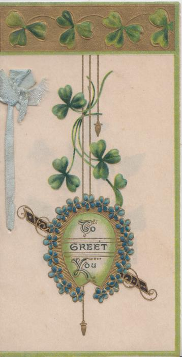 TO GREET YOU in gilt horseshoe with bllue flower border, clover above & in top gilt design, green margins