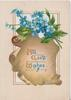 ALL GOOD WISHES( A,G &W illuminated) on brown plaque below blue forget-me-nots